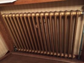 Many vintage cast iron wall mounted radiators