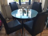 Glass dining table and 4 black leather chairs