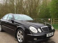 Mercedes E320 black with white leather+panoramic roof