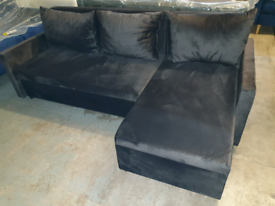 A new stylish soft touch black fabric sofa bed .