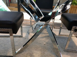 Glass table with 4black and chrome chairs 48inch round