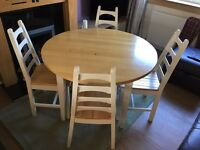 Solid Beech dining room table and four chairs