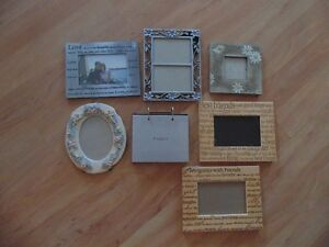 5 unique pictures frames and 1 photo album!