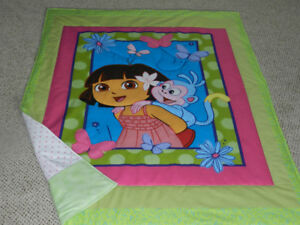 "for sale a New ""DORA"" quilt with flannelette backing"