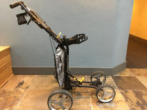Women's golf clubs and folding golf cart in excellent condition.