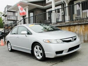 2010 Honda Civic Sport / 1.8L I4 / 5 speed manual / FWD