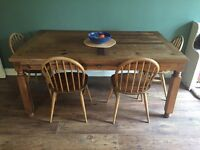 Large wooden country kitchen table.