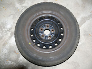 4 winter tires, fits Camry, with rims & plastic covers $200