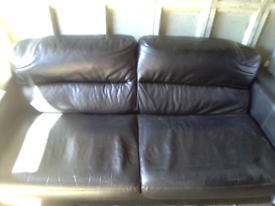 Two and three seater black leather suite