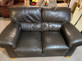 Leather two seater sofa and foot stool pōuffe