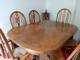 solid wood extendable dining table and six chairs.