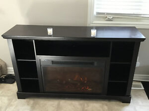 Gently used TV stand with fireplace