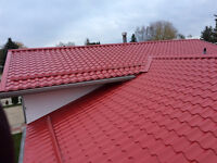 Metal roof tiles over the shingles