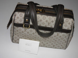 Louis Vuitton bag with LeSportsac and MCM makeup pouches