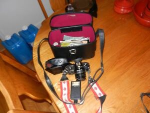 Nikon EM 35 mm  camera and case
