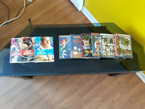 TV stand DVD player and a collection of movies