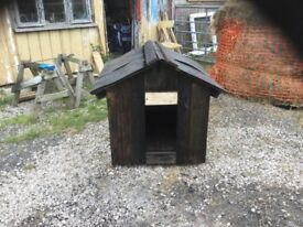 An newly built unused waterproof kennel, for a larger dog.