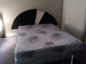 Queen size mattress with headboard, bed frame and box spring.