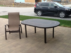 44 X 67 Sorrento Cocoa Bronze dining table with 4 chairs
