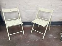 Two vintage wooden garden chairs