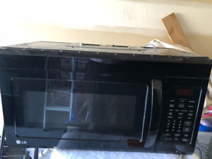 Used LG Black Over the Range Microwave in Good Working Condition