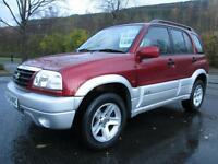 04/54 SUZUKI GRAND VITARA 2.0 16V 4X4 ESTATE IN MET RED WITH ONLY 63,000 MILES