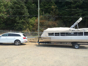 Barely used 20ft pontoon boat and trailer