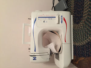 Sewing machine with serger attachment