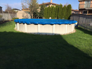 24' round above ground pool complete w/accessories
