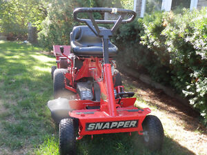 Snapper riding mower and metal trailer.  {moving}