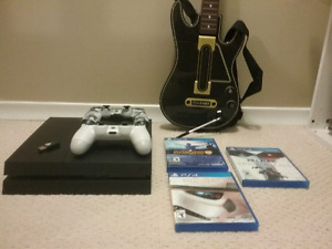 500 GB PS4 bundle with 2 controller and 3 games