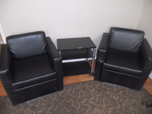 2 brown arm chairs