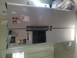 Like new stainless steel frigidaire side by side  fridge