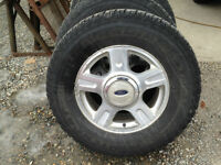 SET OF FOUR - WINTER STUDDED TIRES AND RIMS