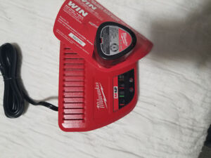 Milwaukee m12 2ah battery plus charger brand new!