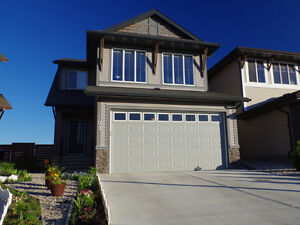 UPGRADED 2 Storey Home with Walkout Basement in Walden Calgary