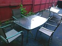 Patio set: glass-top table with 4 chairs