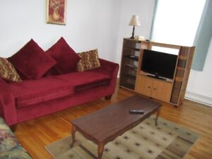 Fully furnished one bedroom plus a den Uptown apartment