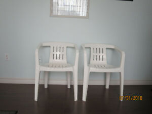 2 plastic outside chairs