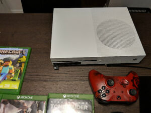 Xbox one with wheel drive joystick Plus 10 games