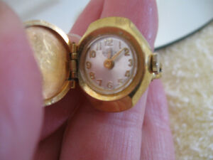 CLASSIC ADJUSTABLE GOLDTONE WATCH / RING..[NON-WORKING]...
