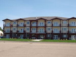 40+ Top Floor Condo with Elevator in Redcliff
