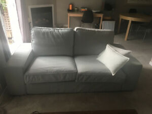 IKEA slipcover couch with 2 covers