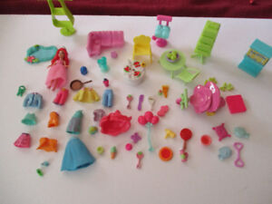 polly pocket doll and accesorries