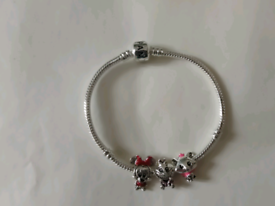 Minnie mouse and Marie Disney Pandora bracelet with charms £20