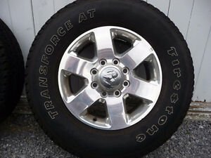 Two dodge 3/4 ton rims and 275/70R/18 tires