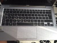 Asus laptop/tablet hardly used excelent condition