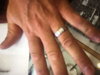 Lost male white gold wedding band, with engraving underneath.