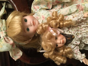 Porcelain dolls for sale. 2 are from Bradbury Collection ..