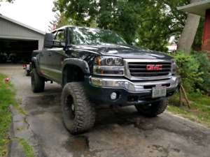 2007 gmc sierra lifted. Trade for stock truck